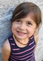 Penny wearing the Violet Jade and Raw Honey Amber necklace